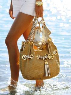 Like this bag...wish I could find it $61.99  http://michaelkorstopshop.de.pn