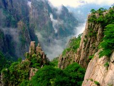 """Huangshan (Chinese: 黃山; pinyin: Huángshān; literally """"Yellow Mountain""""), is a mountain range in southern Anhui province in eastern China. The area is well known for its scenery, sunsets, peculiarly shaped granite peaks, Huangshan Pine trees, and views of the clouds from above. Huangshan is a frequent subject of traditional Chinese paintings and literature, as well as modern photography. It is a UNESCO World Heritage Site, and one of China's major tourist destinations."""