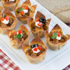 Mini Mexican Tarts   spicy sausage, salsa and cheese baked in wonton cups!