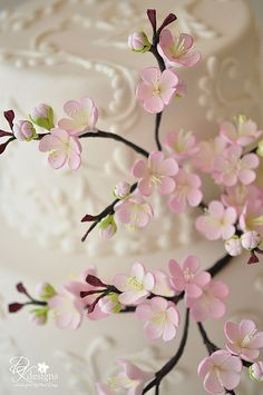 A client recently contacted me and asked if I could create cherry blossom branches for her 3 tier cake. She had purchased a custom bird cake. Sugar Paste Flowers, Icing Flowers, Fondant Flowers, Paper Flowers, Dogwood Flowers, Bolo Fondant, Fondant Cakes, Cherry Blossom Cake, Cherry Blossoms