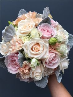 Ice Cream Colours.  Flowers include vendella roses, pale peach carnations, apricot lisianthus, scenecio foliage