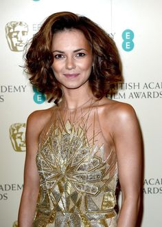 Pin for Later: See All the Best Beauty Looks From the BAFTAs Kara Tointon The actress and Strictly Come Dancing champ was all about the big hair and bronzed makeup for her BAFTAs turn.