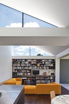 The use of clerestory lighting is not only aesthetically appealing, but also works well with daylighting. With the use of a light shelf, or a white wall shown here, natural light is able to be bounced back further into a space.