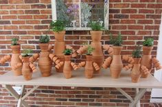The Herb Garden Family -- My husband, Todd & I created this family of patio clay pot people to donate to a silent auction as a fundraiser for Northeast State Community College.  We have Parsley & Chive, Rosemary & Basil, Lavender & Sage, Oregano & Dill, Lemon & Thyme. What do you think? Would you want to adopt one of these cute Garden family couples?