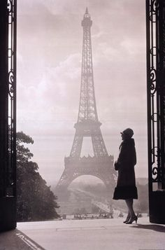 Is it Philippa as she ponders the wonders of her surroundings and the Eiffel Tower Paris?  1920s decade