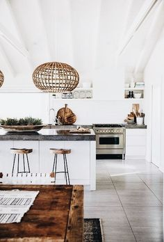 THIS GORGEOUS KITCHEN LOOKS BEYOND STUNNING, WITH THE FABULOUS TIMBER TABLE, MATCHING STOOLS & CANE LIGHT! - LOVE THE ALL WHITE 'LOOK' AGAINST THE TIMBER! LOOKS AWESOME!