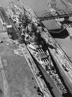 """There was 6-inches to spare when the USS Missouri passed through the Panama Canal in 1945. Wider locks are due to be completed in 2014, allowing 49-metre-wide """"New Panamax"""" ships to use it. But it will remain off limits to the largest container ships."""
