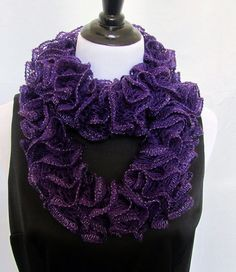 Knitted amethyst purple ruffle scarf with silver metallic thread along edge.  Hand knitted with ribbon yarn.