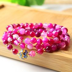 Natural Agate Mala Bead Bracelet  Pink Mala Beads and Mantra Meditation, Male Beads 108  https://loveyogaworld.com/collections/inspiring-jewelry-mala-beads-mala-bracelet/products/natural-agate-mala-bead-bracelet