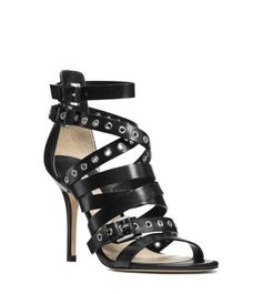 Luxe Vachetta leather straps, shiny grommet accents and a stiletto heel define these daring sandals. With everything from tailored trousers to an evening gown, this pair packs knockout glam.