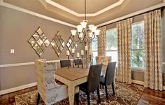 With a tray ceiling and elegant light fixture, this @lennarsa dining room is the picture of elegance!