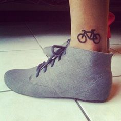I like the tatto but also intrigued with the shoes :O