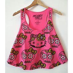 Hello Kitty Sugar Skull Tank  Perfect for Summer, is this Hello Kitty cropped tank top! Print features Hello Kitty as a Sugar Skull with a green bow and white accents. 50% polyester 50% cotton