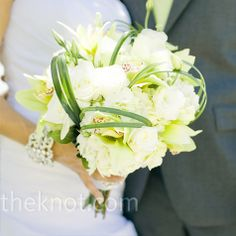 hydrangeas, lisianthus, roses accented with green cymbidium orchids and lily grass loops. LOVE the lily grass loops.