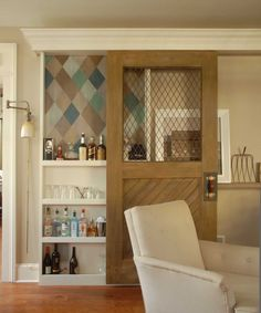 Attach a vintage horse stall door (or any other type of door with a cut-out) to a sliding rail for a beautiful bar or pantry solution. Get the tutorial at Design*Sponge.   - CountryLiving.com