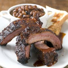 Low-and-Slow Baby Back Ribs - 8 Delicious Recipes for Barbecue Ribs - Southern Living Traeger Recipes, Rib Recipes, Grilling Recipes, Cooking Recipes, Traeger Smoker, Barbecue Ribs, Barbecue Sauce, Bbq Grill, Pastries