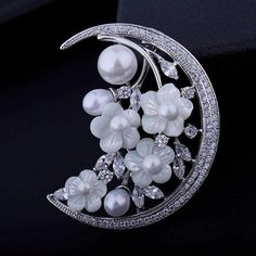 Item Type: BroochesFine or Fashion: FashionShape\pattern: PlantMetals Type: Platinum Plated,CopperStyle: TrendyBrooches Type: Brooch PinsBrand Name: MIGGAGender Moon Jewelry, Pearl Jewelry, Jewelry Sets, Vintage Pins, Vintage Jewelry, Vine Design, Pearl Color, Flower Brooch, Glamour