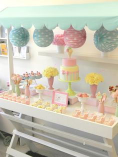 Table with canopy for pretty pastel dessert table ... would be cute for an outdoor shower.