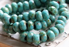 ✿Please read my shop announcement for upcoming shipping days, thank you!!!✿  Love, love, love...... Opaque light turquoise glass with the most gorgeous earthy Picasso finish, simply stunning!! The depth of these is spectacular and they look great with so many metals, recycled sari ribbon, leather and more...... Turquoise Rollers No. 2.....  Q u a n t i t y :: 10 beads  S i z e :: approx. 6x9mm, {1/4 inch = 6.35 mm}  H o l e :: approx. 3mm  C u t / s h a p e :: large hole facete...