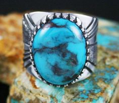 Leonard Nez RARE Gem Grade Bisbee Turquoise Ring   eBay Navajo artist Leonard Nez has created this fine ring by choosing an amazing thick cut rare gem grade natural Bisbee turquoise cabochon to sit atop a heavy ten gauge sterling silver shank. The gem exhibits a wonderful high dome and is classic Bisbee blue with smoky chocolate-reddish-brown matrix seen only in the finest grades.