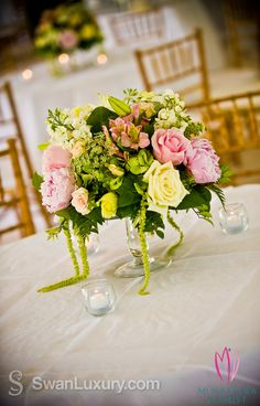 Beautiful low table centerpieces for wedding reception. Floral Designs by McNamara Florist. All Rights Reserved.