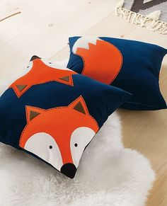 """Look on both sides...appliquéd in wool felt with the fox's face on one side and tail on the other, this soft, sturdy pillow makes an artful and playful addition to any bed.   <br>• Soft poly/wool flannel <br>• Wool/rayon felt appliqué <br>• Embroidered details <br>• 20"""" x 20"""" <br>• Easy envelope closure with snap <br>• Spot clean <br>• Imported"""