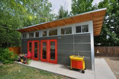 Yes, please.    Guest and Art Studio with Garage: Studio Shed Lifestyle - contemporary - garage and shed - denver - Studio Shed