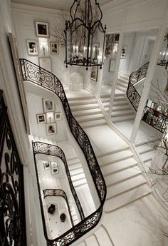 I love the look of this house. I always wished to have a house with a grand staircase like this. It looks so elagant and the railing looks as if it was made of lace. The mirrors make the hall look twice as big making it look like part of a casle <3
