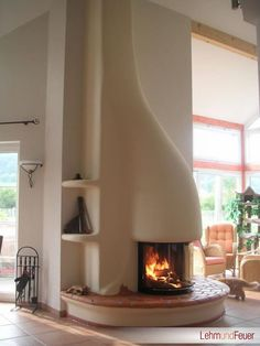 Fireplace design with free-form adobe like built-in Lehmundfeuer, Germany