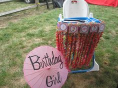 Birthday Girl parasol with decorated high chair for one year old birthday party.