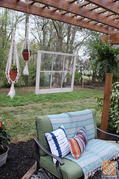 Backyard Makeover: Pergola with Bohemian Style - hang the window from the wedding on the back
