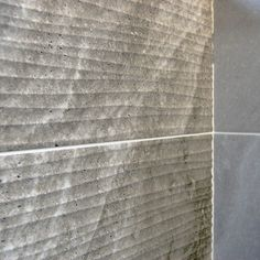Ditto Dark Grey Wave tile a ceramic Inkjet matt finish stone effect wall tile by British Ceramic Tile BCT. A Decor Tile with a curving linear pattern.  Perfect as a feature wall or feature panel in conjunction with the field tiles and looks fantastic in bathroom shower areas or as a kitchen splash back. Also available in the Ditto range are matching dark grey/ light grey floor tiles, the Light Grey Wave tile and light grey field wall tile. The cheapest tiles online.