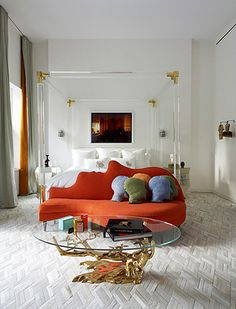 love the lucite bed with gold touches + that amazing coffee table