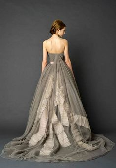 Vera Wang - The back of this gown with the soft grey tulle (with the pleated ivory silk ribbon flowing down in long streamers) spills out into a chapel length train.  The bodice is fitted & strapless with a low back. There is also a nod to the old 'Watteau style' of the 17-18th centuries that falls from the bodice.  via Flickr