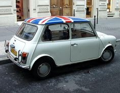 Austin Mini with British flag on it...drove this car for years.
