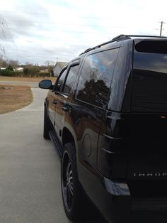 "My '12 black on black on black Tahoe aka ""Sexy Bitch"" - mom car"