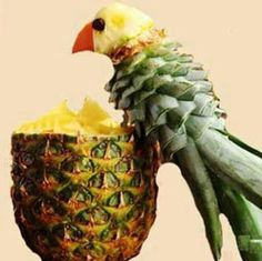 Food art with pineapples. Parrot.
