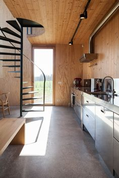 GAFPA used low-cost materials to build this Japanese-inspired weekend retreat in northern Belgium, which features a slender spiral staircase