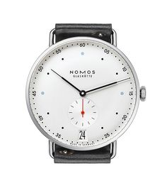 The @nomosglashuette Metro 38 Datum, with its Bauhaus-influenced design, features extra-large date indicators at 6 o'clock along with a small seconds subdial, blue dot hour indices at 3, 6, and 9 o'clock and a red lacquered seconds hand, contrasting with the galvanized, white silver-plated dial. More at: http://www.watchtime.com/wristwatch-industry-news/watches/showing-at-watchtime-new-york-2015-nomos-metro-38-datum/ #nomosglashuette #watchtime #watchnerd #menswatches