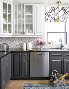Herringbone patterns are in!  Grey and white make the perfect kitchen color combo.