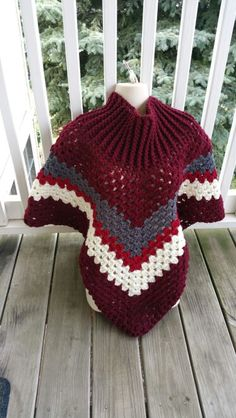 This Is #12! Hot Off My Hook! Project: Cowl-Neck Poncho Started: 25 July 2015 Completed: 28 July 2015 Model: Madge the Mannequin Crochet Hook(s): 7.00mm Yarn: Redheart Super Saver Color(s): Claret, Charcoal, Burgundy & Aran Pattern Source: Simply Crochet Magazine Issue No. 25 Pattern Design: Simone Francis Notes: This is my 12th cowl neck poncho! I used a 7mm hook for the entire piece.