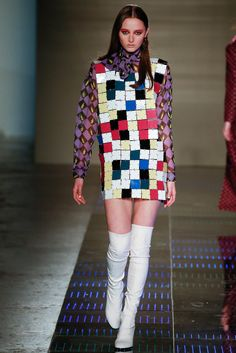 04.05.15 Short skirts with tall boots and graphic prints in bright colors are all huge traits of fashion in the 1960s. Here we see a contemporary remastering of the trend by Au Jour Le Jour.