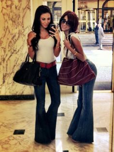 These women are just my style, simple white top, extreme Bell bottom jeans. i love it. Cute bags. Not crazy about the belt. I also like both their hairstyles. <3