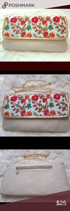 """Embroidered clutch crossbody bag Beautiful convertible clutch that can be carried as a crossbody bag. Embroidered flap look very dressy and elegant. One pocket on the back and another interior pocket. Gold chain is detachable. 10"""" L 6"""" H 0.5"""" W Avenoir Bags Clutches & Wristlets"""