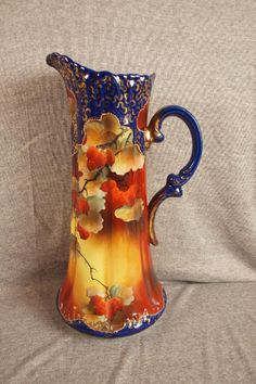 Nippon hand painted china tankard with berries on cobalt ground, 16