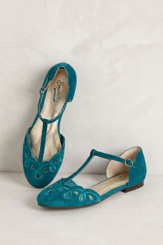 t-strapped scalloped teal flats. Classy touch to an outfit with a pop of color