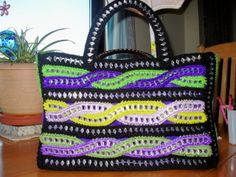 made from beer/soda can tabs. www.recycledcrochet.webs.com