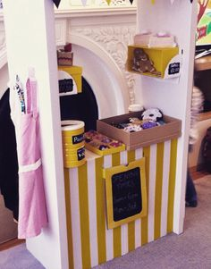 Ikea hack with skylta shop/market. Decorated with yellow duck tape (Hobbycraft/amazon) and blackboard paint. All cakes handmade from felt.