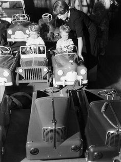 Two children test the toy cars at the Christmas display at Farmers department store in Sydney. December 12, 1951.