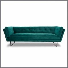 With a nod to mid-century design, the clean lines of the Manhattan Velvet Sofa provide a luxurious seating experience.
